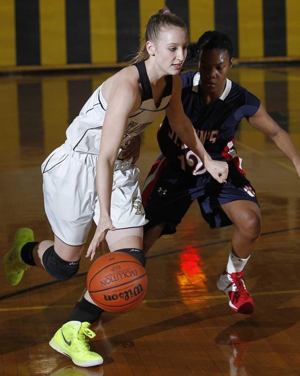 St. Anthony's Rebecca Musgrove (12) drives around St.