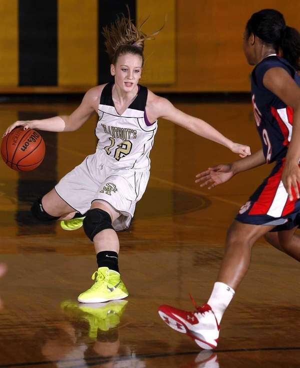 St. Anthony's Rebecca Musgrove (12) pulls up in