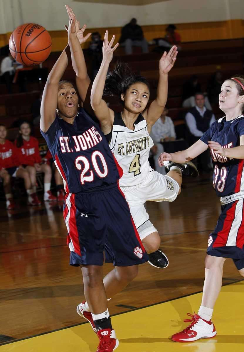 St. Anthony's point guard Tyla Parham (4) tries