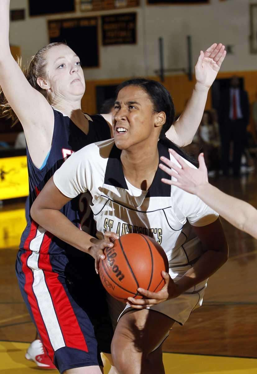 St. Anthony's Symone Kelly (24) drives hard in