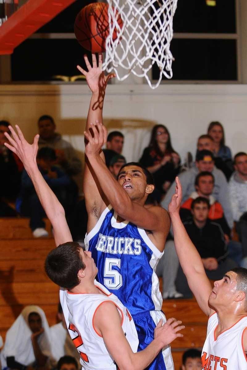 Herricks High School #5 Shawn Mathew tries to