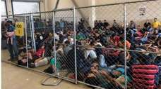 Migrant families overcrowding a Border Patrol facility on