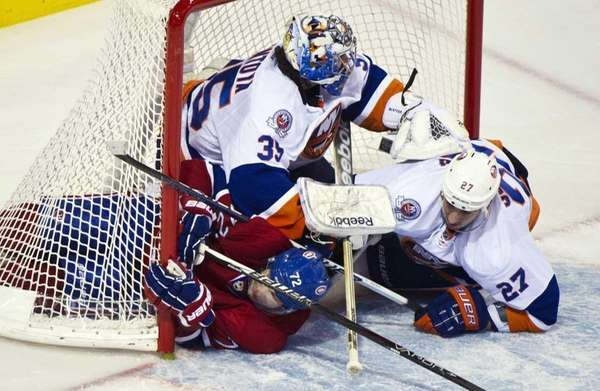 Montreal Canadiens' Erik Cole and New York Islanders'