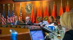 Lawmakers at a meeting of the Nassau Legislature's