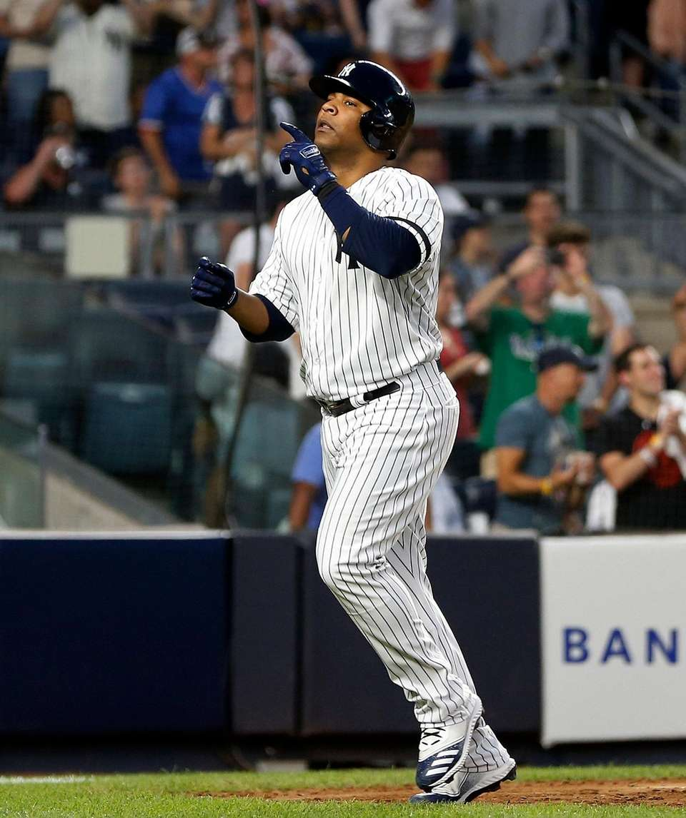 Yankees designated hitter Edwin Encarnacion celebrates his home