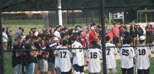 Mourners remember Michael McDermott, 37, of Smithtown, at