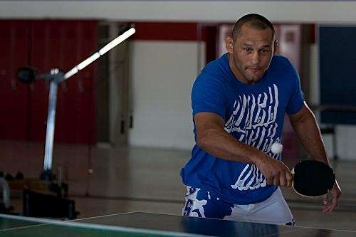Dan Henderson plays ping pong during a break