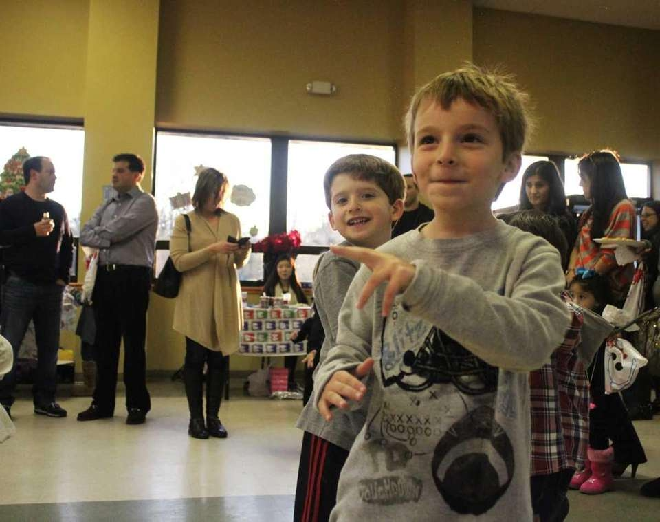 Alex Brandoff, 5, dances with friends at the