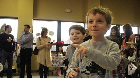 Alex Brandoff, 5, dances with friends at the