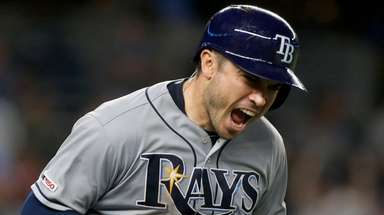 Rays catcher Travis d'Arnaud reacts after his three-run