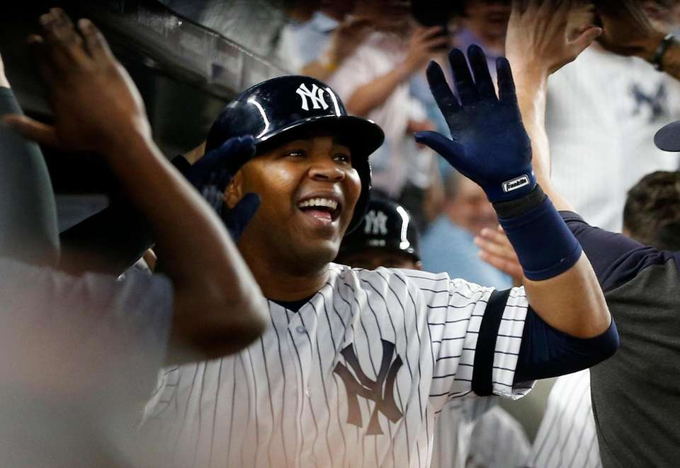 Yankees designated hitter Edwin Encarnacion celebrates his two-run