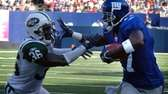 Giants receiver Plaxico Burress tries to elude Jets