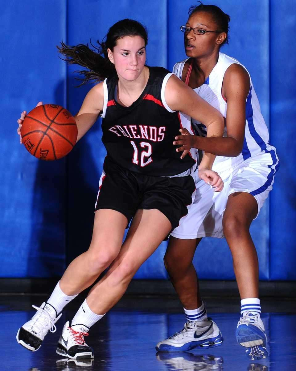 Friends Academy point guard #12 Rose Mangiarotti, left,