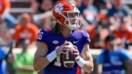 Trevor Lawrence drops back to pass during Clemson's