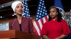 U.S. Rep. Ilhan Omar, D-Minn., joined at right