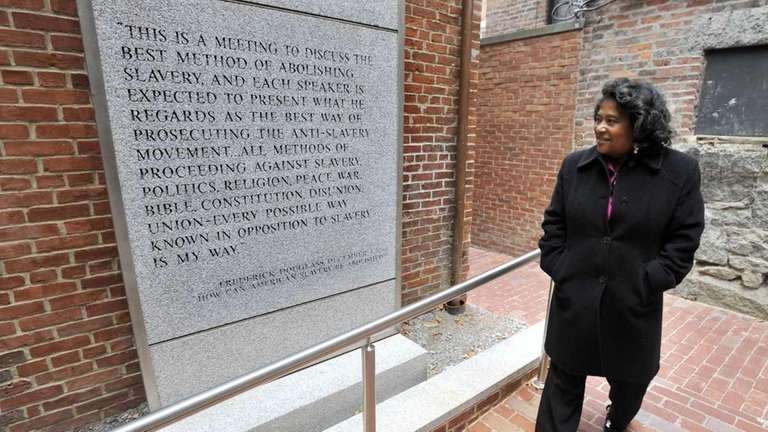 Executive director Beverly Morgan-Welch, walks past a quote