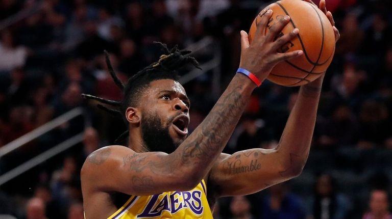 Los Angeles Lakers guard Reggie Bullock attempts a