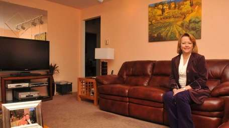 Suzanne Nelson, pictured in her living room, wants