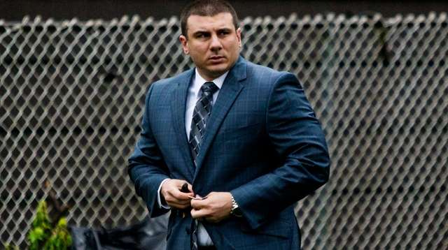 NYPD Officer Daniel Pantaleo leaves his house in