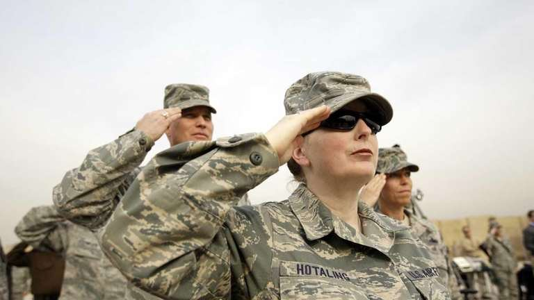 U.S. Army soldiers salute during ceremonies marking the