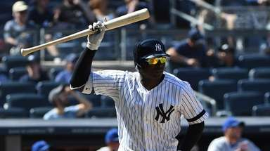 Yankees shortstop Didi Gregorius raises his bat before