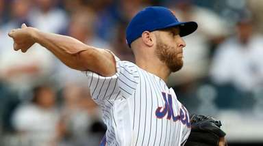 Mets pitcher Zack Wheeler delivers during the first