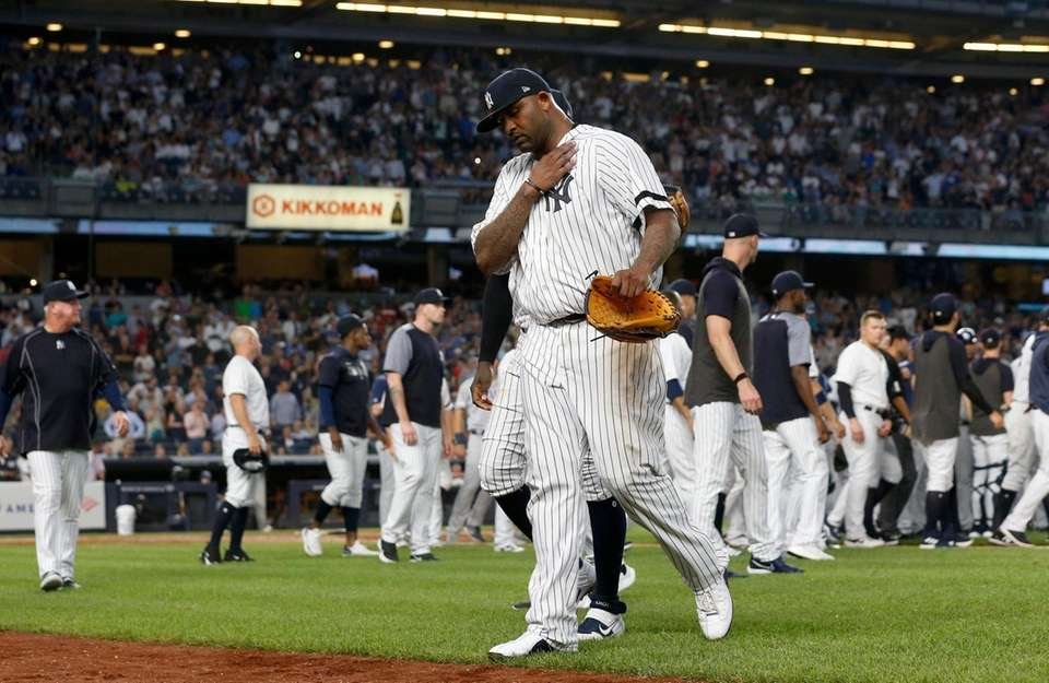 Yankees pitcher CC Sabathia walks to the dugout