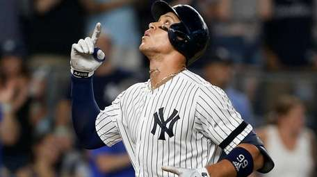 Yankees outfielder Aaron Judge celebrates his eighth-inning two-run