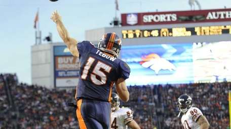 Denver Broncos quarterback Tim Tebow throws a pass
