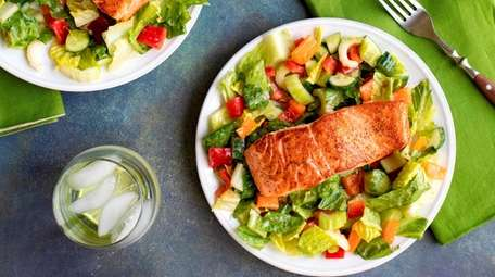 Simple seared salmon served on a chopped salad