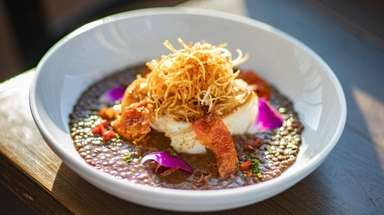 Pan seared cod with lentils is served at