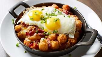 Breakfast poutine is composed of eggs, regular and