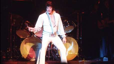 Elvis Presley performing in Las Vegas in December
