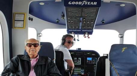 Glenn Quillin, 103, relaxes with Capt. Bill Bayliss