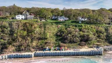 This Sound Beach property, top left, is listed