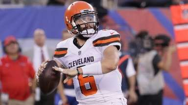 Browns quarterback Baker Mayfield releases a pass for