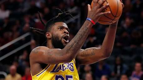 Los Angeles Lakers guard Reggie Bullock attempts a