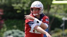 Patriots quarterback Tom Brady follows through on a