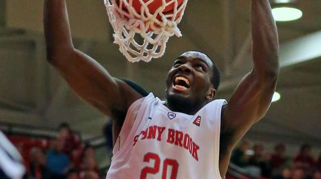 Stony Brook's Jameel Warney dunks the ball in
