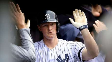 DJ LeMahieu #26 of the Yankees is congratulated