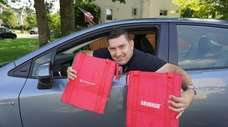 Bethpage resident Brian Krauss makes food deliveries for