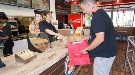 Burger King employee Carlos Urrutia of Wantagh, left,