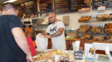 Brian Krauss, left, picks up a delivery order