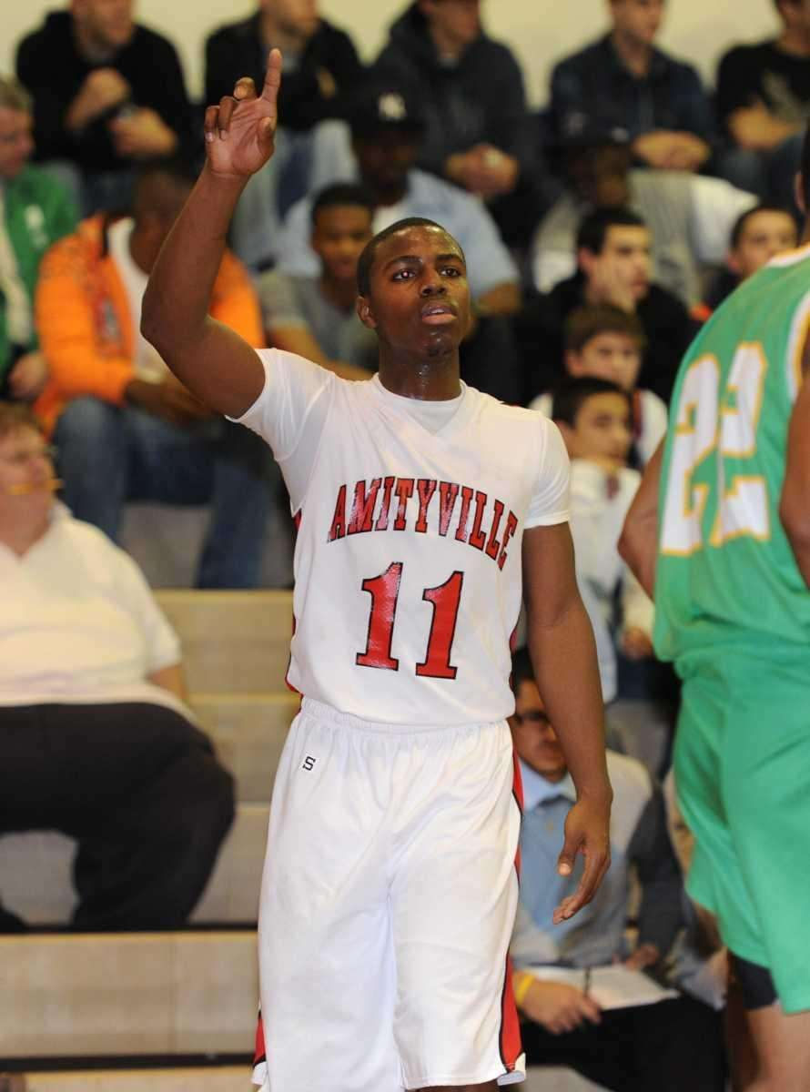 Amityville's #11 Richie Hobson signals to a teammate