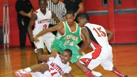 Amityville's #11 Richie Hobson traps a loose ball