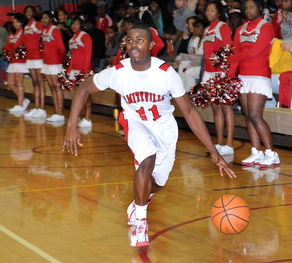 Amityville's #11 Richie Hobson drives down court during
