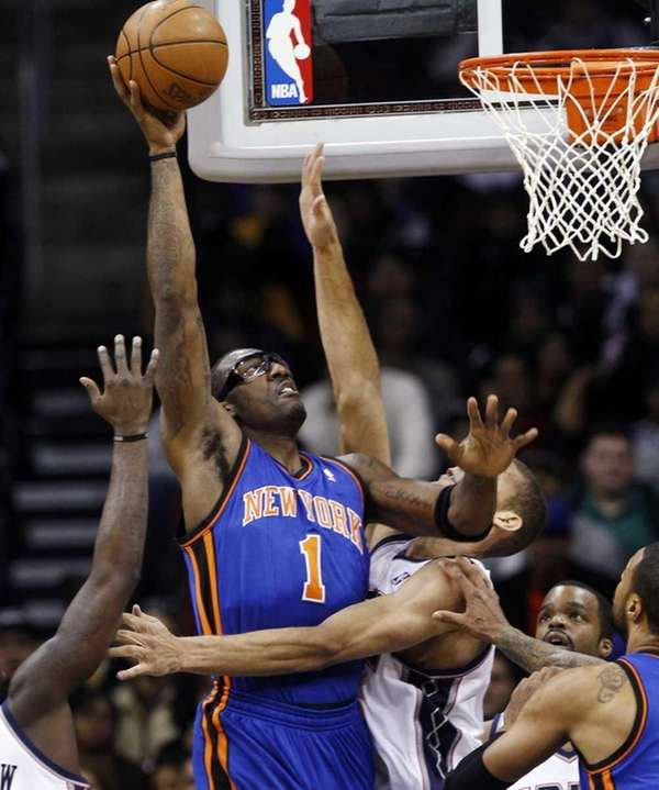 The New York Knicks' Amare Stoudemire (1) puts