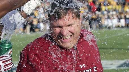 Temple defensive coordinator Chuck Heater is doused by
