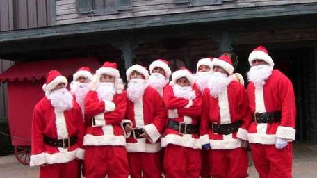 A group of Santas poses at the inaugural
