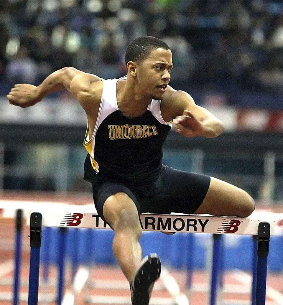 Uniondale's Chris Armour clears the last hurdle in